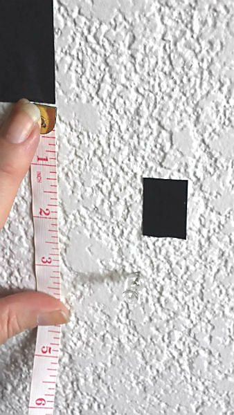 measuring and marking with tape and pushpins gallery wall