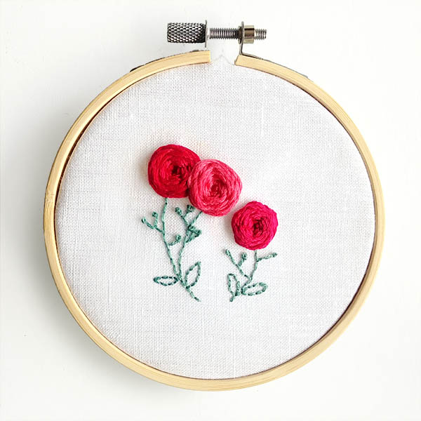 Woven wheel stitch embroidered roses